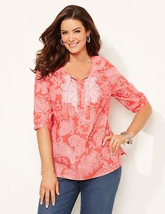 Lavalette Peasant | Catherines Printed with a delicate allover paisley pattern, our lightweight top is the perfect addition to your warm-weather wardrobe. Intricate embroidery at the neckline, along with the tassel keyhole tie detail, completes this beautiful peasant top. Scoop neckline. Three-quarter sleeves. Darted bust. Side slits at hem. Catherines tops are perfectly proportioned for the plus size woman. #catherines #plussizefashion #springstyle #peasanttop