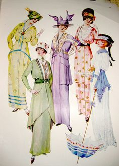 """July 1914 frocks. I keep wondering how slender you needed to be, so those """"overskirts/whatever"""" like the white & blue dress, flattered"""