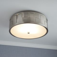 Featuring a woven basket design, the Nassau Flush-Mount Ceiling Light is a beautiful choice for a contemporary update. Its stylish, textured shade is made of metal for lasting durability. A frosted glass underside hides its three bulbs and emits a soft gl
