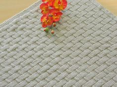 Free knitting pattern for Linus Baby Blanket. Very simple knit in 2 sizes.