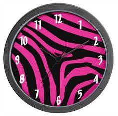 Hot pink and black zebra print wall clock by CafePress.