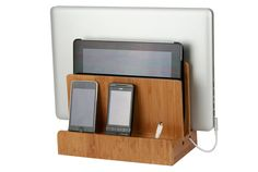 If your guy's electronics are cluttering up the bedroom, this sleek organizer is for you, er, him. His phone, tablet and laptop can all get juice in one neat place.  Bamboo Multi-Charging Station, $34.99; GreatUsefulStuff.com.