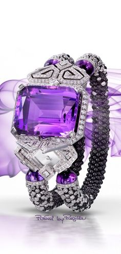 A bracelet that has, in one side, a clock surrounded by white diamonds, and is decorated with a giant amethyst believe boliviana.Alta jewelry.