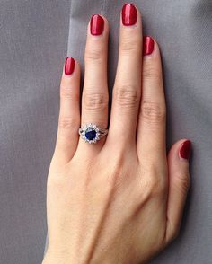 """And here's a little peek at bride Carol's gorgeous #ringselfie. Would you say """"yes!"""" to this halo #sapphire sparkler? We know we would. #TWSSheSaidYes More from Enoch and Carol's #Safari-themed #wedding up now at www.theweddingscoop.com"""