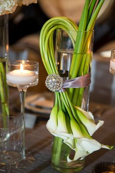A beautiful floral arrangement of white calla lilies accented with a ribbon and rhinestone brooch. Floral Centerpieces, Table Centerpieces, Wedding Centerpieces, Wedding Table, Floral Arrangements, Wedding Bouquets, Wedding Flowers, Wedding Decorations, Table Arrangements