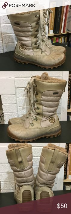 "Timberland | Beige / Cream Waterproof Snow Boots Good used condition. Wear is shown in photos at all angles. Waterproof. Color is ""bone leather"". Looks beige. Shaft stands 11.5"" tall. Measures around the ankle is 13.5. Style is Earthkeeprs Mount Holly Tall Lace Duck. True to size. Please ask me questions you have prior to purchase. Size is 9.5. Timberland Shoes Winter & Rain Boots"