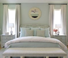 Andrew Howard Design -perfectly balanced bedroom retreat - Soothing palette of blues, whites, gray, soft blue, seafoam, sage - nailhead trim, bench - White Bungalow 5 three drawer side table - crown moulding - patterned drapery, panels