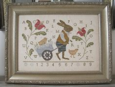 cross stitch pattern : peter and peep country stitches with thy needle and thread sampler easter bunny rise of the guardians diy. $10.00, via Etsy.
