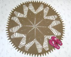 """This is a large round jute rug with a sunburst motif, it will blend well in almost any decor, from modern to rustic. It's got a nice wheel shape and would be well suited for southwestern decor as well. It's a big area rug, handmade with all natural jute twine, measures about 53"""" in diameter, and is about 1/4"""" thick. It would be a wonderful place for your dog or cat to sleep and play, most of them love the material."""