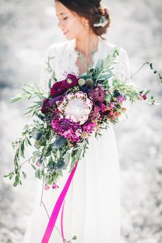 King protea fuchsia bouquet with matching ribbons