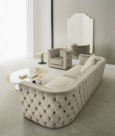 Italian tufted upholstered living: LEANDRO sofa - LEANDRO armchair - LUDMILLA central table - LUDMILLA sidetable - MADDALENA mirror