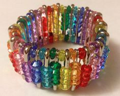 Make a bracelet with colored beads and safety pins.