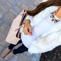 IG @mrscasual <click through to shop this look> Chicwish faux fur vest. Statement necklace. Maternity skinny jeans. Ankle booties. Tory burch york tote.