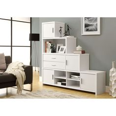 Make space for vases, books, and other items with this white step bookcase. The bookcase has many shelves and drawers, so you can hide away some objects while displaying others. The stylish bookcase can have right- or left-facing steps.