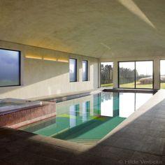 Exclusief betonnen binnenzwembad met een speciaal motief in mozaïek, skimmer zwembad | De Mooiste Zwembaden