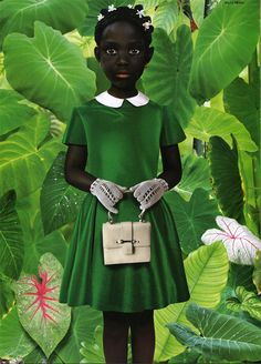 Ruud van Empel (Van Empel's working method is a complex one. He photographs 4 or 5 professional models in his studio and takes many detailed photographs of leaves, flowers, plants and animals. The models pictures are mixed with these images using the Photoshop program and with clothes photographed separately on a tailor's dummy.)
