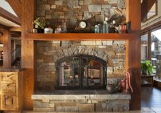 Perfect Fireplace, stone, timber framed.  Perfect!  Can we duplicate this in the great room?