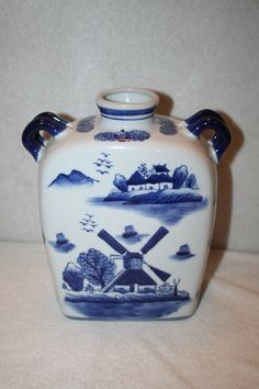 """This is a great ceramic porcelain 'Jug' vase with Windmill design. It measures approx: 9.5"""" x 8"""" x 3.5"""" and is in  MINT condition. There is an Oriental stamp on bottom. Please email me with any questions $50 FREE SHIPPING TO US RESIDENCE Vases For Sale, Windmill, Oriental, Porcelain, Mint, Stamp, Ceramics, Free Shipping, Design"""