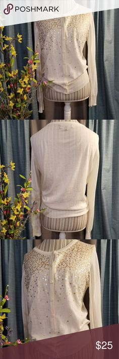 🌻🌺🌻JONES NEW YORK SEQUIN CARDIGAN!! SIZE:medium   BRAND:Jones New York    CONDITION:like new, no flaws    COLOR:cream/gold/silver  Beautiful cardigan!!   🌟POSH AMBASSADOR, BUY WITH CONFIDENCE!   🌟CHECK OUT MY OTHER ITEMS TO BUNDLE AND SAVE ON SHIPPING!   🌟OFFERS WELCOME!   🌟FAST SHIPPING! Jones New York Sweaters