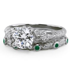 I like the leaf pattern and the green saphires on the wedding band.  Enjoy these textures. Ginkgo Matched Set from Brilliant Earth