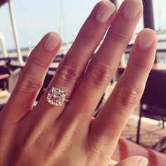 Single diamond solitaire on a thin diamond band... Can't go wrong with this gem! 9.5 mm cushion cut brilliant wedding engagement rings i like the square look without diamonds encircling it