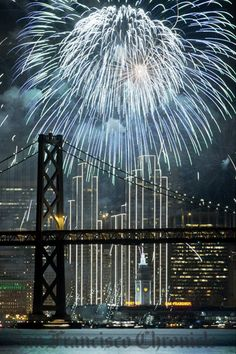 Fireworks on the Embarcadero in San Francisco, Calif., silhouette the San Francisco-Oakland Bay Bridge as residents rang in the New Year on Friday, January 1, 2016