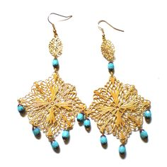 Make an instant pair of chandelier earrings by adding a large brass filigree to your fave beads.
