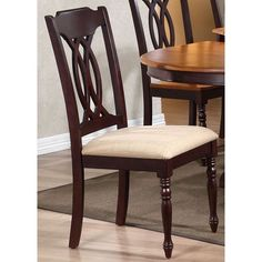 Traditional dining side chair with a turned leg design. This set includes two (2) chairs and is shown in a upholstered seat/mocha frame.