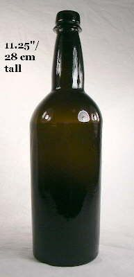 This bottle was blown in a dip mold which is indicated by the textured surface to the bottle body below the shoulder and the smooth glossy glass surface at the shoulder and neck (click photo to enlarge).  It has a crudely applied mineral finish (with a bit taller upper portion as compared to the earlier bottles above), a faint sand pontil scar on the base, and likely dates from the 1850s.