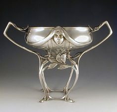 Hugo Leven  Polished pewter tazza with Art Nouveau maiden head to front and back  Germany  c.1906