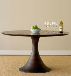 Modern wooden round table.  Simple and clean.
