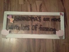 sanded old window and painted it with a saying and added paper cut out and hooks