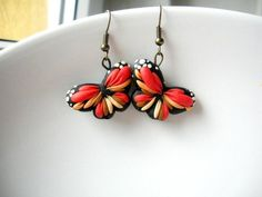 Poly clay butterflies earrings by ciupacabra, apparently a Romanian artist
