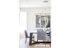 "The dining table and art from Barber Gallery were carefully selected in keeping with the cohesive colour scheme on the main floor.   See more of this home in ""25-Year-Old Powerhouse Couple Build in Waterloo"" from OUR HOMES Waterloo Holiday/Winter 2016/2017 http://www.ourhomes.ca/articles/build/article/25yearold-powerhouse-couple-build-in-waterloo"