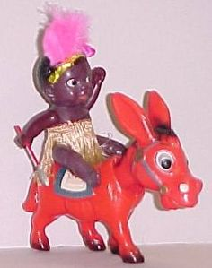 1950's Japanese celluloid AFRICAN NATIVE riding Red DONKEY nodder.  Jointed black native is carrying spear and wearing grass skirt. Courtesy: GASOLINE ALLEY ANTIQUES, Antique Toys & Collectibles, SEATTLE, WA (USA).