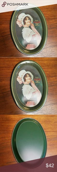 """*RARE* Vintage 1973 Coca Cola Tin Tray Awesome little piece of history. Photo is a 1914 depiction of a woman drinking a Coke mini. Trays/tins were printed in 1973. Great for holding jewelry or even used as a coaster. Approx 6 x 4.33"""" (I have a lot more Vintage Coca Cola in store & offer a 20% discount on 3+ items!) Vintage Other"""