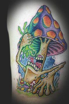 Trippy mushroom eating a green man | Tattoomagz.com