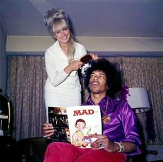 Jimi Hendrix having his hair done while reading Mad magazine 1968