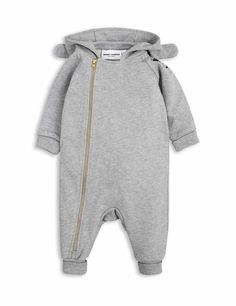 Onesie in grey melange by Mini Rodini with a black panda print at the shoulder and a hood with sewn-on bunny ears. The onesie has a small tail at the back.