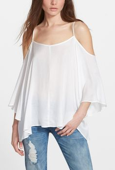 Love this look.   Flowy white cold shoulder blouse and distressed jeans.