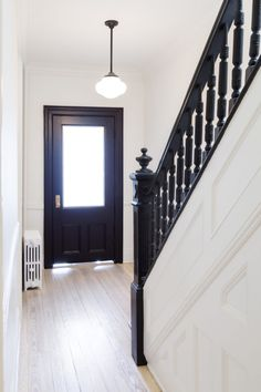 White Arrow renovates Brooklyn rowhouse with navy millwork and modernist furniture Black Stair Railing, Black Staircase, Staircase Railings, Staircase Design, Banisters, Spiral Staircases, Modern Staircase, Stairways, White Banister