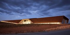 The corten steel exterior panels establish the facade of this wineries 3 part design, each section of the building expressing a different aspect of the winemaking process.