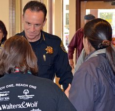 Chief Grgurina meets with Special Olympics athletes and event coordinator Dori Fontaine.
