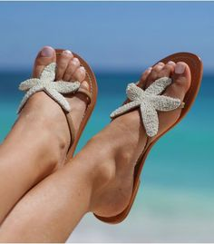 "These beautiful sandals feature a diamonte starfish design on a natural leather base and is one of Aspiga's best selling sandal. As seen in EasyLiving, House & Garden and Vogue.com.  Handmade in India.  Genuine leather upper with white stitching.  Flat leather sole with very small (0.25"") non-slip low heel."