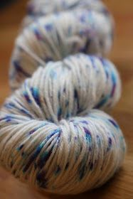 I love Wilton's Violet food coloring and I love making speckled yarn.  Why not combine the two and see if I can break Wilton's Violet foo...