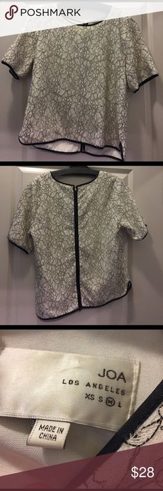 White Lace Blouse w/ Faux Leather Trim Short sleeve white blouse with a lacy overlay and a faux leather trim. Barely worn and in great condition! Great for work. Zipper up back JOA Los Angeles Tops Blouses