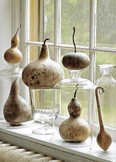 We got this tip from Country Home, too: dried gourds become mini sculptures when paired with old vases and glassware.