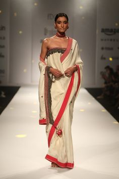 2ded0a07589 Perfect lady in a white saree. This understated look packs a style punch  with off-shoulder blouse and bold red borders.
