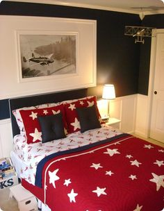 Hmmm. Love those bold navy walls with the board and batten. Bedding from Pottery Barn, I think??