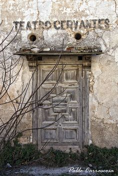 Santa Eulalia, Valencia, Spain (insp.-The different variations of the tones/ colors on the wall & the design of the door.)